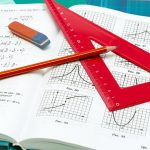 school supplies and textbooks on mathematics close up
