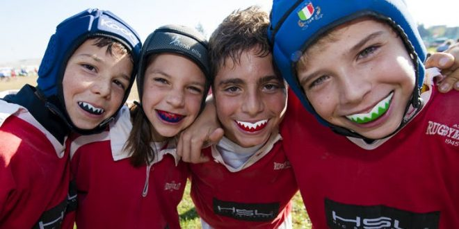Children have fun playing sports and don't need to satisfy ...