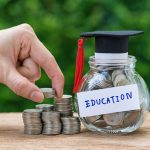 Woman hand holding stack of coins money and glass jar with full of coins and graduates hat label as Education, education or savings concept